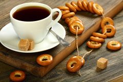 Small bagels in placer and a cup of tea. Royalty Free Stock Image
