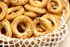 Small bagels. With poppy seeds in a wicker basket stock photo