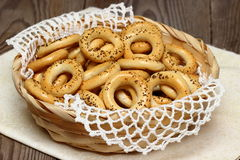 Small bagels. With poppy seeds in a wicker basket royalty free stock images