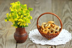 Small bagels. With poppy seeds in a wicker basket Shallow DOF stock image