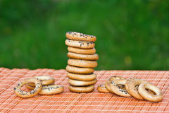 Small bagels are on the table. On a green background Stock Photo