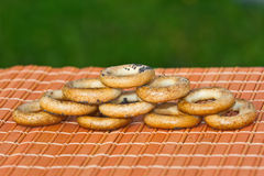 Small bagels are on the table. On a green background Stock Photos