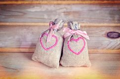 Small bags with embroidered hearts. Stock Images
