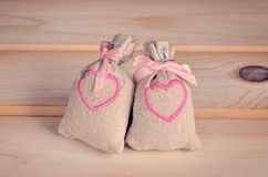 Small bags with embroidered hearts. Stock Photo