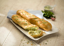 Small baguettes with herbal butter Stock Photography