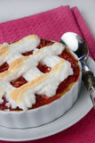 Small baked pie with red jam Royalty Free Stock Photography