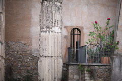 A small balcony. With flowers in pots in a medieval building. Rome, Italy Royalty Free Stock Photo