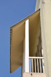 Small balcony with shield under blue sky Royalty Free Stock Images