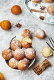 Small balls cottage cheese doughnuts in powdered sugar. Homemade small balls cottage cheese doughnuts in powdered sugar stock image
