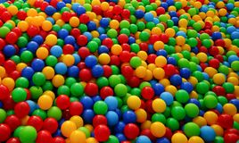 Small balls of different colors on the Playground royalty free stock photography
