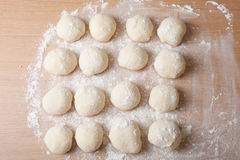 Small balls of dough with flour for pizza or cakes and scones. S Royalty Free Stock Images