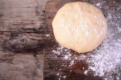 Small balls of fresh homemade dough on floured Royalty Free Stock Photo