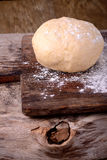 Small balls of fresh homemade dough on floured Stock Photos