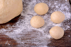 Small balls of fresh homemade dough on floured Royalty Free Stock Images
