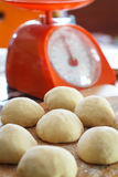 Small balls of fresh homemade pizza dough. On floured wooden board Stock Photos