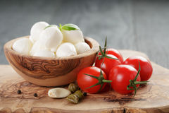 Small balls of mozzarella with basil leaves ant Royalty Free Stock Image