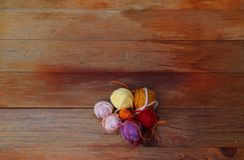 Small balls of wool on a red wooden table stock photo