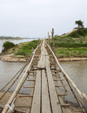 Small Bamboo Bridge. A small, narrow bridge crossing a small river entering the Irrawaddy in northern Myanmar Royalty Free Stock Photography