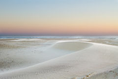 Small barchan dunes on the beach Stock Image