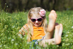 Small barefooted girl in grass Royalty Free Stock Photo