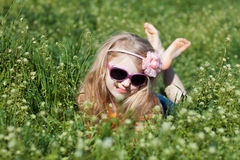 Small barefooted girl in grass Royalty Free Stock Photos