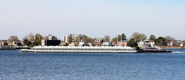 Small Barge Steaming Through Norfolk Virginia Harbor Stock Photography
