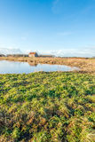 Small barn reflected in the water surface Royalty Free Stock Photos