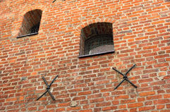 Small barred window in an old brick wall Stock Photography