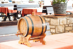Small barrel of wine on table Stock Images
