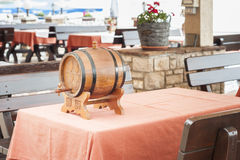 Small barrel of wine on table Royalty Free Stock Photo