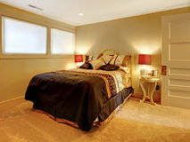 Small basement bedroom with guest bed. Stock Images