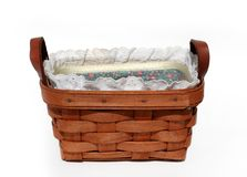 Small Basket. Basket made from wood - leather handles with a fabric and lace eyelet liner royalty free stock images