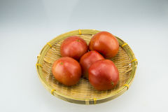 The small basket andTomatoes. The small basket, put a red tomato, very beautiful Royalty Free Stock Photos