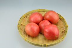 The small basket andTomatoes. The small basket, put a red tomato, very beautiful Stock Photography