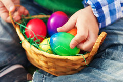 Small basket with colorful easter eggs Stock Images