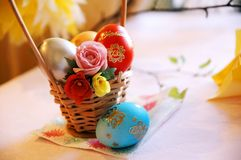 Small basket with Easter eggs Royalty Free Stock Photography