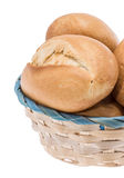 Small basket filled with buns on white Royalty Free Stock Photography