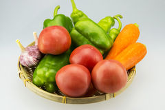 The small basket filled with a lot of vegetables Royalty Free Stock Photo