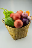 The small basket filled with a lot of vegetables Stock Photography