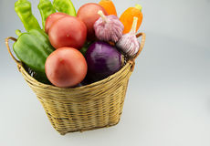 The small basket filled with a lot of vegetables Royalty Free Stock Photography