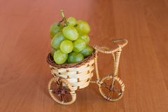 Small basket with grapes Stock Photos