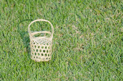 Small basket on the grass. Small handmade woven baskets Royalty Free Stock Photos