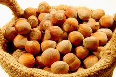 Small basket of hazelnuts Stock Photography