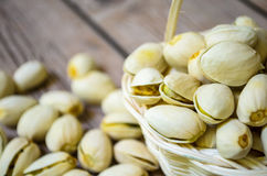 Small basket of pistachios. Pistachio nuts in a small white basket Royalty Free Stock Photography