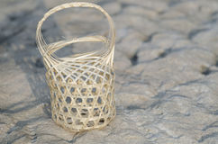 Small basket on the rock. Small handmade woven baskets Stock Image