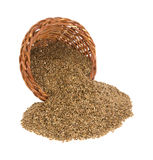 Flaxseed spilling from basket Stock Images