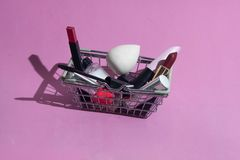 A small basket from the supermarket with makeup products. stock image
