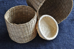 Small baskets. Several hand-knitted small baskets made of reed,  grass and bamboo Stock Image