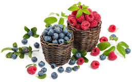 Small baskets with fresh blueberries and raspberries Stock Photography