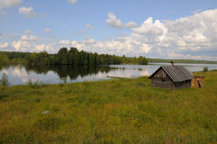 Small bathhouse on a lake shore. A small bathhouse on a beautiful lake in a forest stock photography